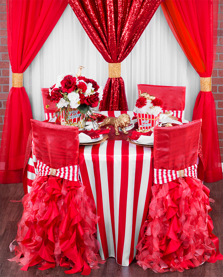 carnival themed event with red glitz sequins and striped tablecloth