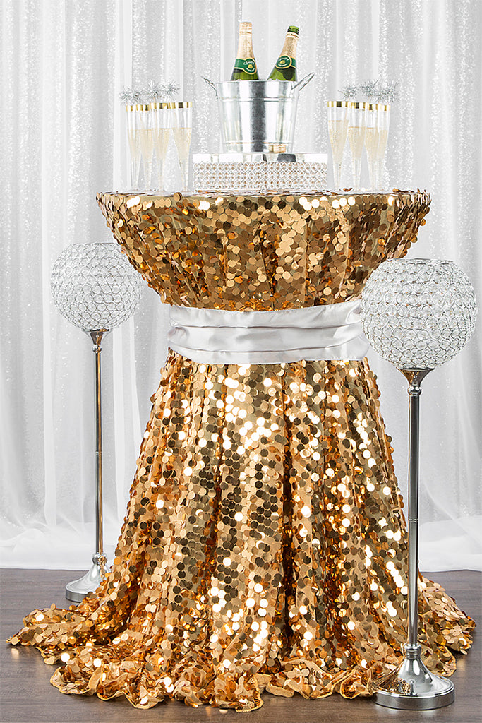 new year's cocktail table with gold payette sequin tablecloth and silver glitz sequin drape
