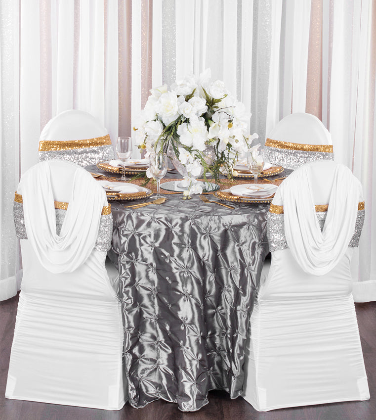 gold and silver wedding with glitz sequins, sheer drapes, napkins, charger plates, table runner, and chair covers