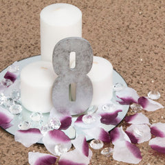 4 Step Guide to DIY Wedding Centerpieces flower petal table numbers