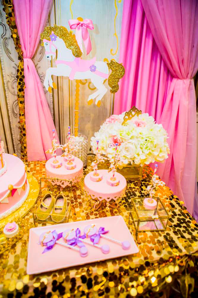 Princess carousel baby shower with pink, lavender, and gold sequins