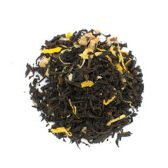 ginger flavored black tea cup and leaf