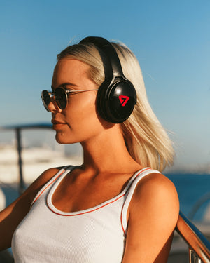 Woman Wearing Red Colored Neon 100 Bluetooth Headphone