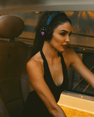Woman Wearing Violet Colored Neon 100 Bluetooth Headphone