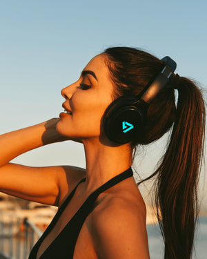 Woman Wearing Blue Colored Neon 100 Bluetooth Headphone