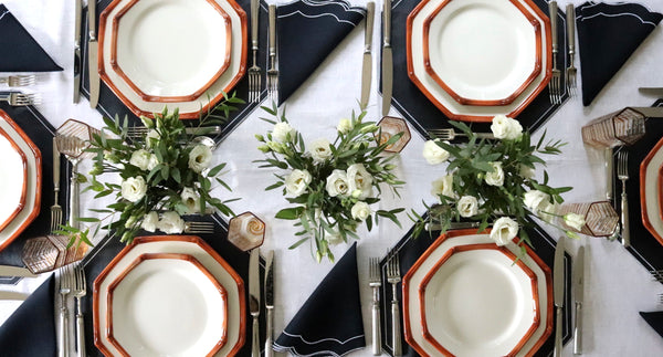 tablescape on white linen tablecloth