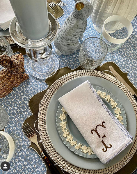 Camilla placemats in olive and rattan placemats in rustic white