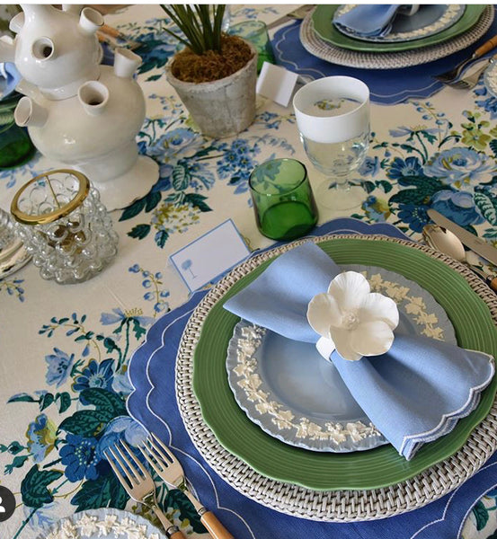 Stella placemats in marine and rattan placemats in rustic white