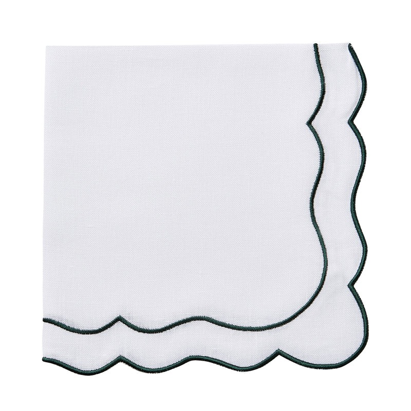 Scalloped white and dark green linen napkins