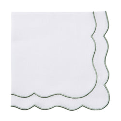 Scalloped white and green linen napkins