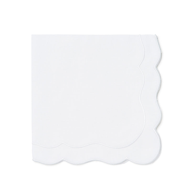 Scalloped white linen napkins