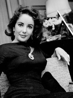 Liz Taylor wearing a brooch on her cleavage