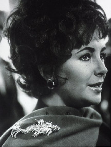 Elizabeth Taylor wearing a brooch on her scarf