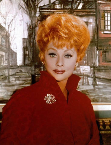 Lucille Ball wearing a brooch on her jacket