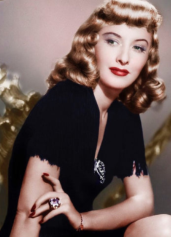 Barbara Stanwyck in the 40s - wearing a brooch