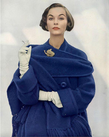 Photo of a 1950s woman with a blue coat