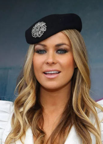Carmen Electra - wearing a hat and brooch - Getty Images