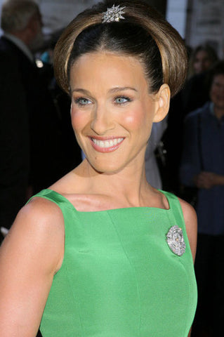 Sarah Jessica Parker wearing a green dress and a brooch