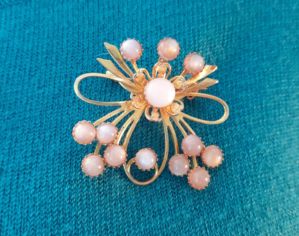 Back to listings Vintage Gold Tone Floral Atomic Moonglow Brooch