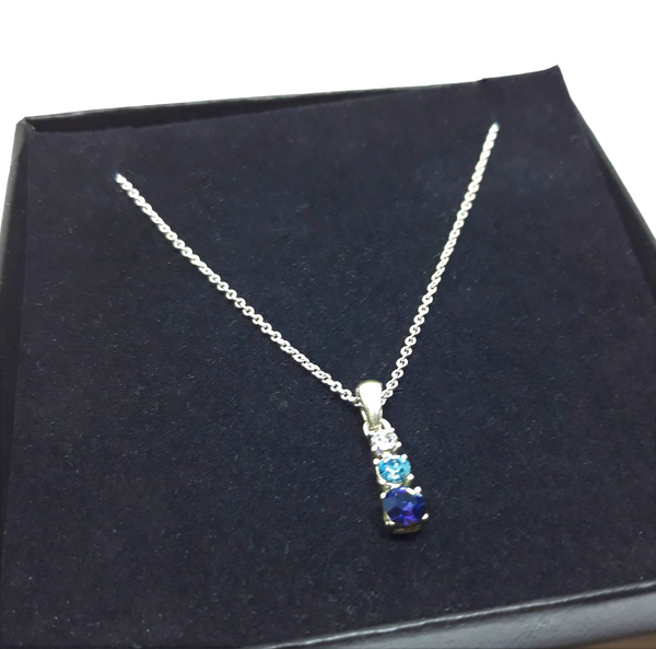 Gorgeous Blue Rhinestone Pendant and Silvertone Necklace