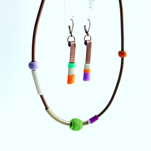 This necklace is made with shock cord silcone, metal and wood beads. It has an interlocking magnetic clasp and hangs 44cm long. This pic also shows the Matchstick earrings that pairs with this piece. Each sold separately.