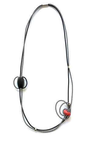 This piece is made with 2 different shock cords and mixed beads. It has a magnetic clasp and hangs 98.5cm long.
