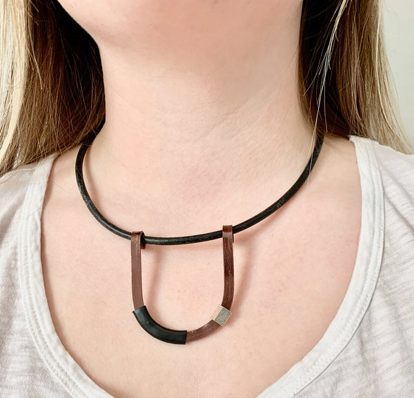 Isabelle is wearing the Bronze with Black Uline on a fine leather cord that hangs 42cm.