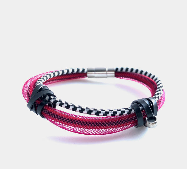 This Bracelet has netted tubing with two different kinds of shock cord and aluminum wire with a magnetic clasp. It is 19cm.