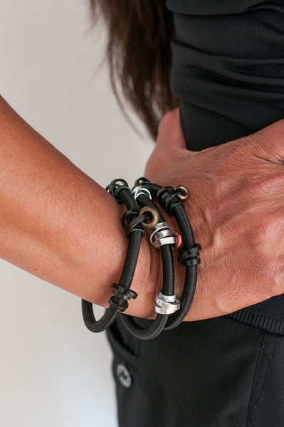 Arvi is wearing 3 Loopt Bracelets in a heavy or with black or silver thin aluminum wire.
