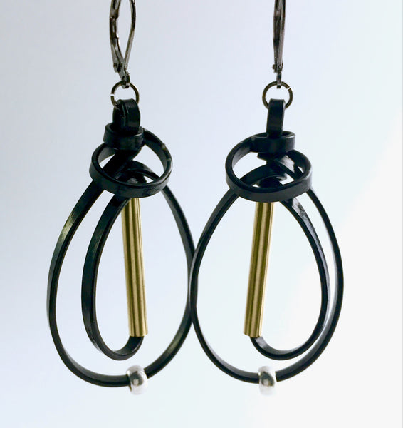 These are black coloured aluminum wire with mixed metal beads. They hang about 5cm in length.