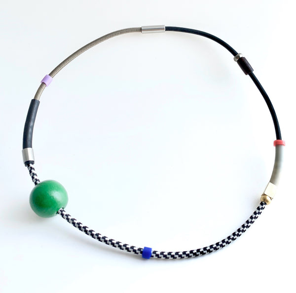 This necklace is made with shock cord silcone, wood and metal beads. It has an interlocking magnetic clasp and hangs 46cm long.