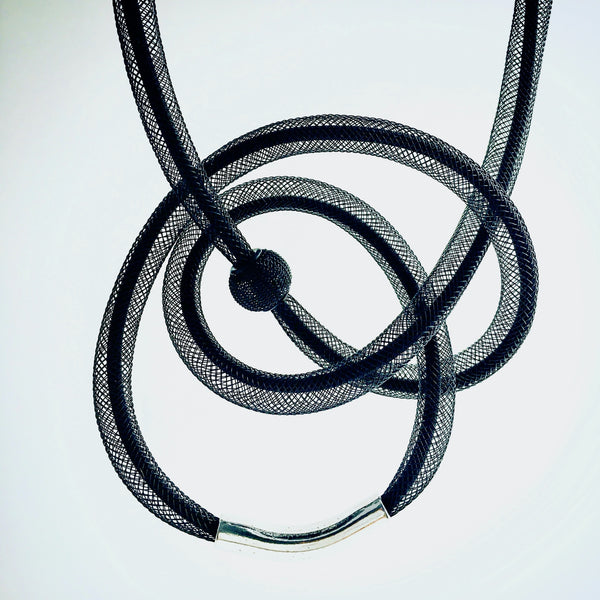 This Tubular is made with black shock cord and black netted tubing. it is 115cm