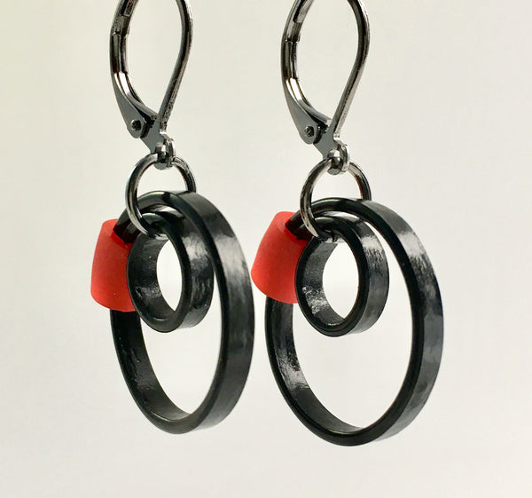 These Reel earrings with a red accent are a simple fairly small earring that hangs 2cm long.