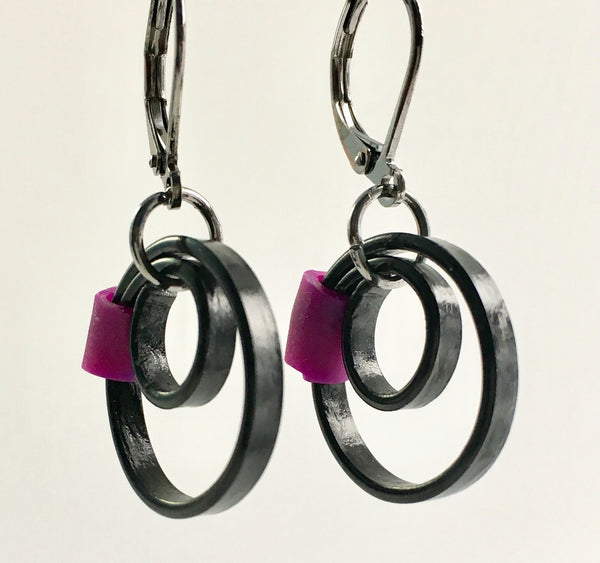 These Reel earrings with a purple accent are a simple fairly small earring that hangs 2cm long.