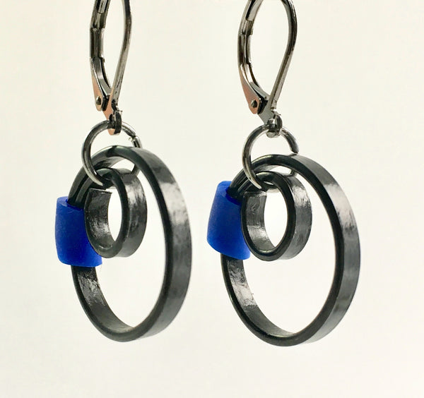 These Reel earrings with a royal blue accent are a simple fairly small earring that hangs 2cm long.