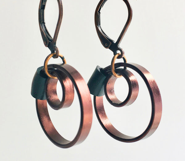These Reel earrings with a black accent are a simple fairly small earring that hangs 2cm long.