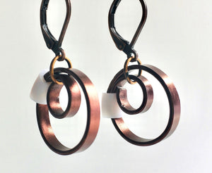 These Reel with a white accent hang about 2cm.