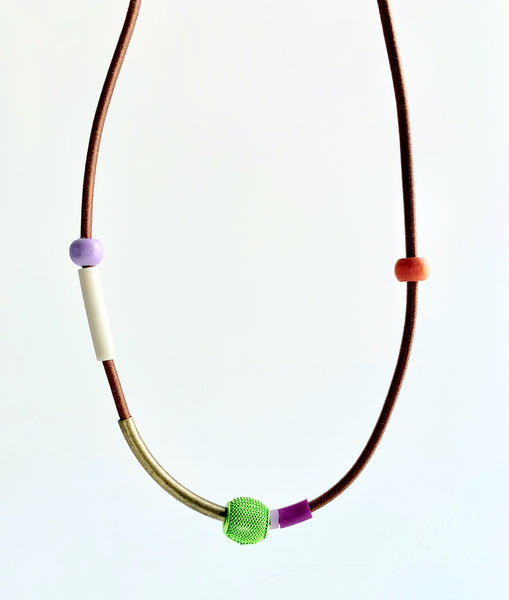 This necklace is made with shock cord silcone, wood and metal beads. It has an interlocking magnetic clasp and hangs 44cm long.