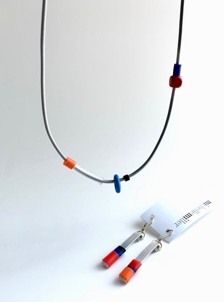 This necklace is made with shock cord silcone and wood  beads. It has an interlocking magnetic clasp and hangs 46cm long. It is paired here with the Matchstick earrings that go best with it. Each sold separately.