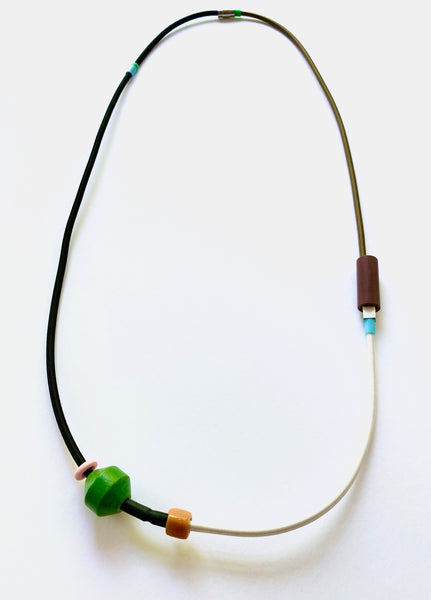 This peice is made from 3 different shock cords, silicone tubing, mixed beads and has a magnetic clasp. It hangs 126cm.
