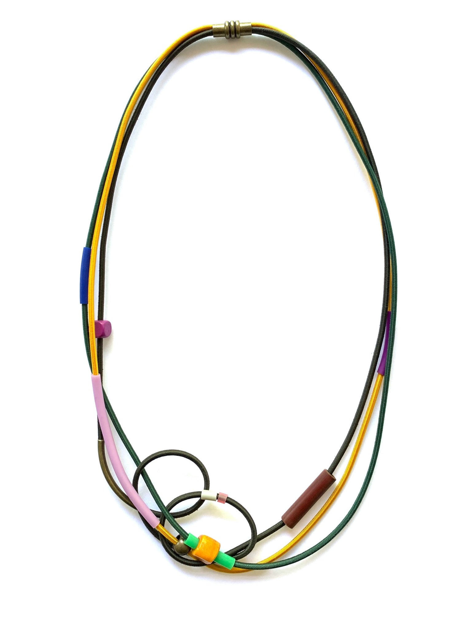 This piece is made with shock cord, silicone tubing,mixed beads and a magnetic clasp. It hangs 68cm long.