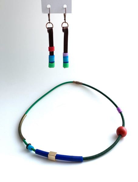 This necklace is made with shock cord silcone, wood and metal beads. It has an interlocking magnetic clasp and hangs 42cm long. This pic shows Matchstick earrings that pair well with this piece.