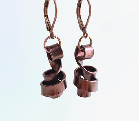 These Loopt earrings are super light weight and hang about 2cm long. They are made of aluminum wire.