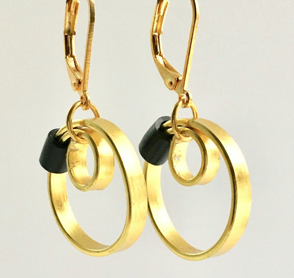These Reel Earrings are made of gold coloured aluminum wire with added black silicone beads. They hang about 2cm in length. All Earrings sport non nickel leverback hooks unless noted otherwise.