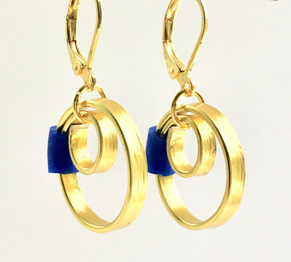 These Reel Earrings are made of gold coloured aluminum wire with added royal silicone beads. They hang about 2cm in length. All Earrings sport non nickel leverback hooks unless noted otherwise.