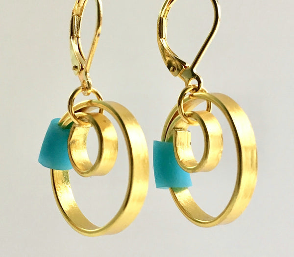 These Reel Earrings are made of gold coloured aluminum wire with added  turq/blue silicone beads. They hang about 2cm in length. All Earrings sport non nickel leverback hooks unless noted otherwise.