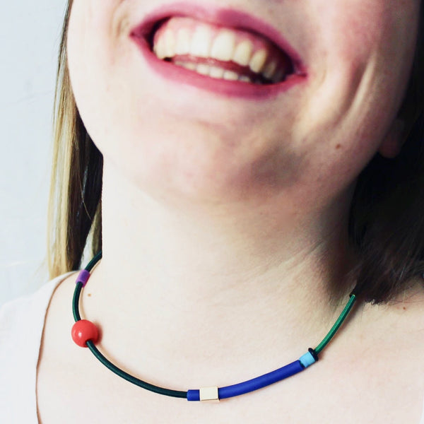 Isabelle wears Colour Collage choker in greens, royal+red.