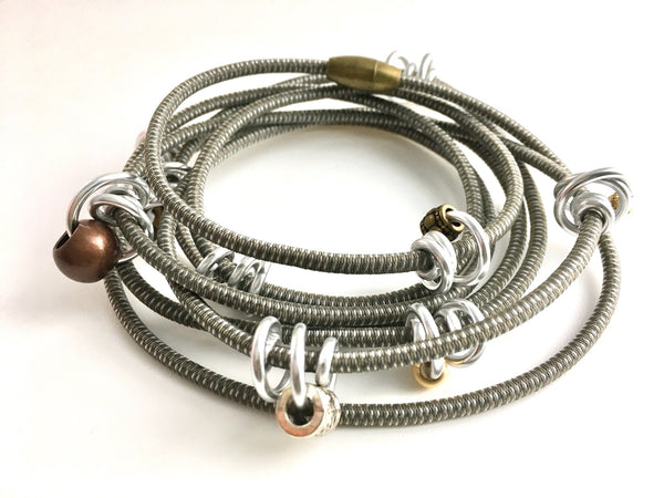 This is long Loopt necklace/bracelet in taupe with round silver wire.