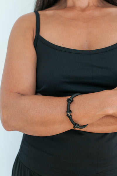 Arvi is wearing a Loop Bracelet in Heavy cord and fine Black aluminum wire.