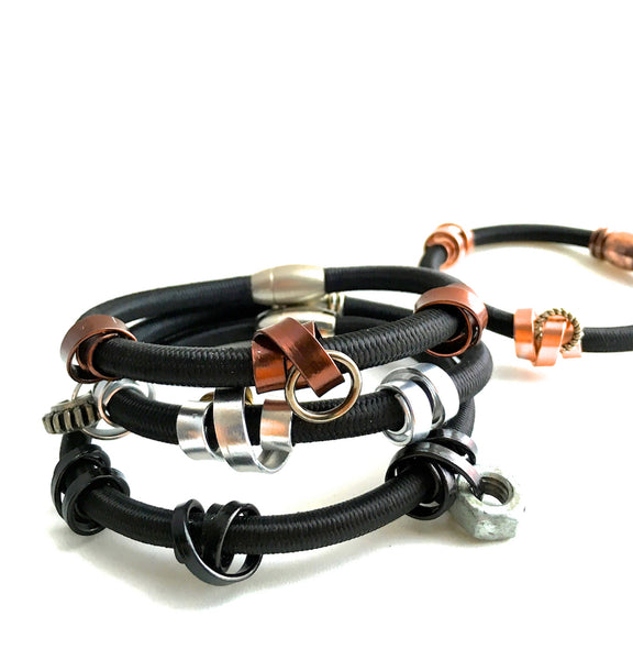 Mix of 4 Loopt bracelets in flat copper, flat bronze, flat silver and thin black on heavy cord.